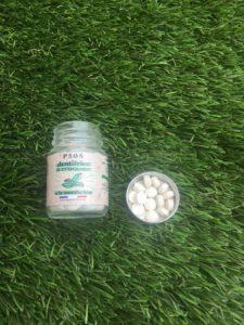 Petites pastilles dans un petit pot en verre